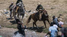 Homeland Security will investigate after images show agents on horseback grabbing migrants