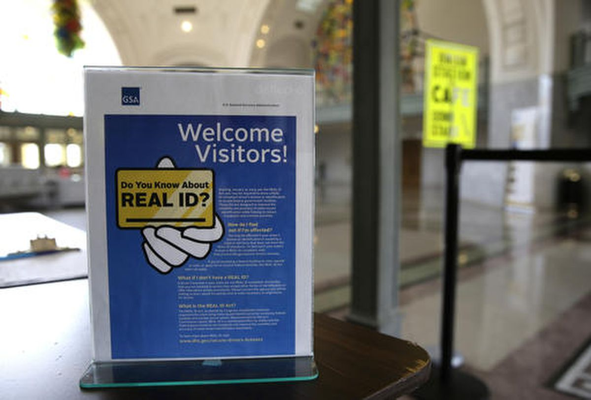 A sign at the federal courthouse in Tacoma, Wash., is shown to inform visitors of the federal government's REAL ID act, which requires state driver's licenses and ID cards to have security enhancements and be issued to people who can prove they're legally in the United States. (AP Photo/Ted S. Warren, File)