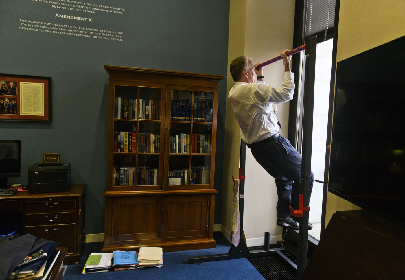Sen. Dan Sullivan does chin-ups next to his desk on June 19, 2019. Sullivan said he often does them in the middle of the workday, especially in the weeks leading up to his Marine Corp Reserve physical fitness tests. (Marc Lester / ADN)