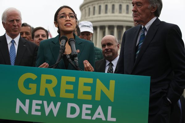 Rep. Alexandria Ocasio-Cortez (D-N.Y.) speaks as Sen. Ed Markey (D-Mass.), right, and other Congressional Democrats listen during a news conference in front of the U.S. Capitol on Thursday, Feb. 7, 2019, in Washington, DC. **FOR USE WITH THIS STORY ONLY**(Alex Wong/Getty Images/TNS)