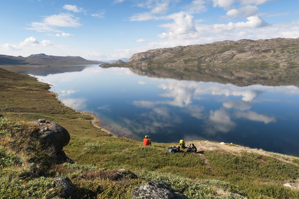 On the Arctic Circle Trail in Greenland, the 14-mile-long Lake Amitsorsuaq makes for a scenic spot to drop the gear. (Photo by Dina Mishev for The Washington Post)