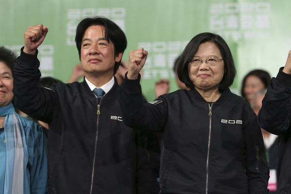 Taiwan's 2020 presidential election candidate, Taiwanese President Tsai Ing-wen, right, and her running mate William Lai celebrate their victory with supporters in Taipei, Taiwan, Saturday, Jan. 11, 2020. Taiwan's independence-leaning President Tsai Ing-wen won a second term in a landslide election victory Saturday, signaling strong support for her tough stance against China. (AP Photo/Chiang Ying-ying)