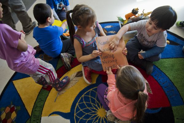 Students divide into groups using lists of the Yup'ik names they use in the preschool classroom on April 12, 2018. At Cook Inlet Native Head Start, 20 students ages three to five spend their pre-schools days speaking in Yup'ik as part of an immersion program. Some of them will head to kindergarten at College Gate Elementary School in the fall to join the Anchorage School District's brand new Yup'ik immersion program. (Marc Lester / ADN)