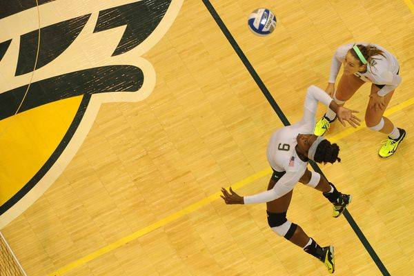 Chrisalyn Johnson, of UAA, goes up to spike the ball as teammate Leah Swiss is ready for the return against Western Washington in the title match of the Division II West Regional Volleyball Championships at the Alaska Airlines Center at UAA in Anchorage, Alaska, on Saturday, December 3, 2016. (Bob Hallinen / Alaska Dispatch News)