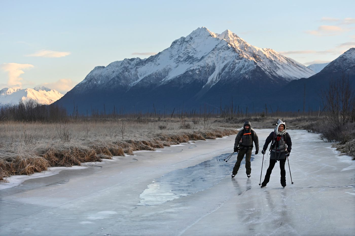 Ben and Melina Reynolds, of Wasilla, skate on Wasilla Creek a couple miles from the access area at Rabbit Slough in the Palmer Hay Flats State Game Refuge. (Marc Lester / ADN)