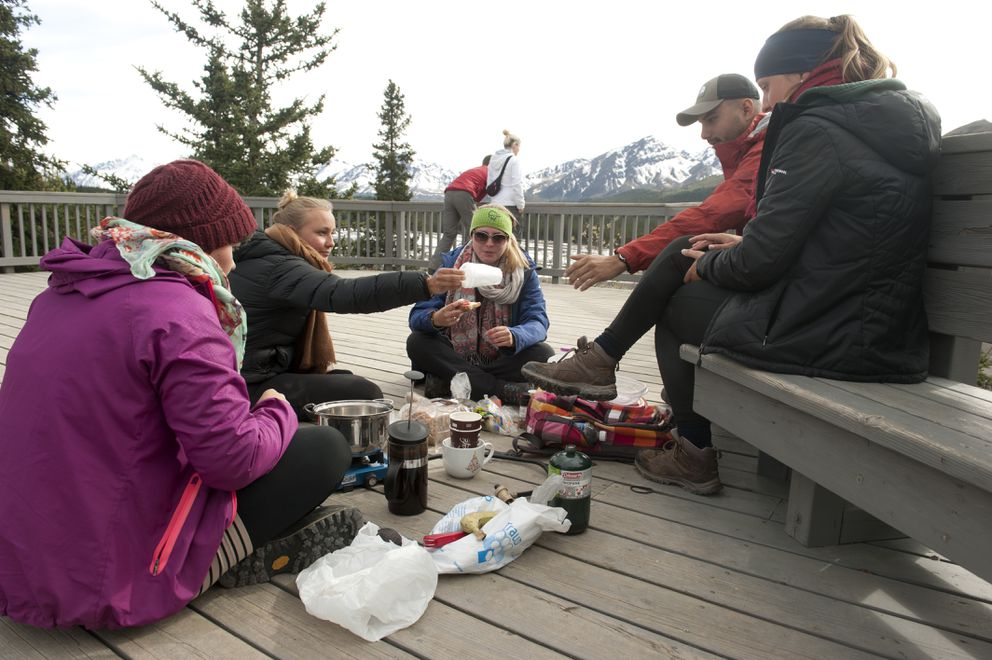 Magdalene Rueb, Leonie Sayer, Elena Zerbini, Izzy Magana and Katherina Litz have lunch on the deck at the Teklanika River rest stop in Denali National Park and Preserve on Wednesday, May 18, 2016. The ladies are from Germany and Magana is from California. (Bob Hallinen / Alaska Dispatch News)