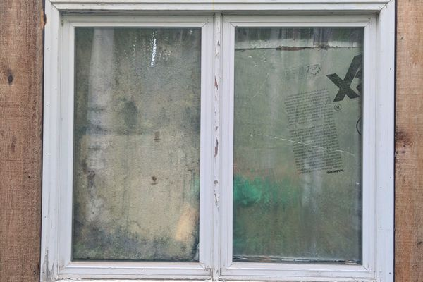 Most of the windows at the Pesika house had been covered with insulation. Photographed Aug. 28, 2018. (Michelle Theriaut Boots / ADN)