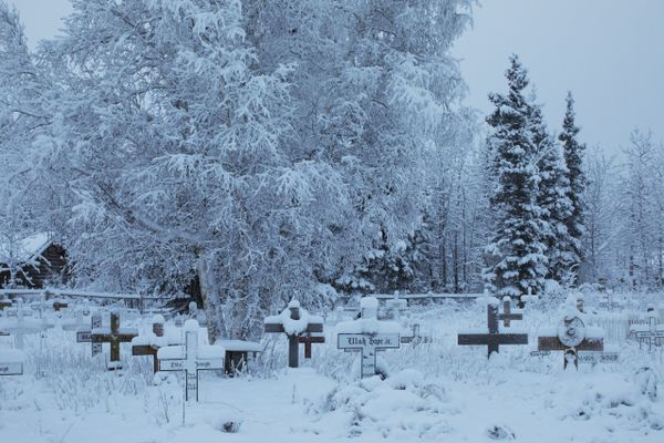 The town cemetery in Beaver, Alaska, a village of 60 or so near the Arctic Circle, Dec. 4, 2016. In a state where hamlets like Beaver have a way of vanishing as people leave opportunities elsewhere, a sense permanency can be hard to come by. (Ruth Fremson/The New York Times)