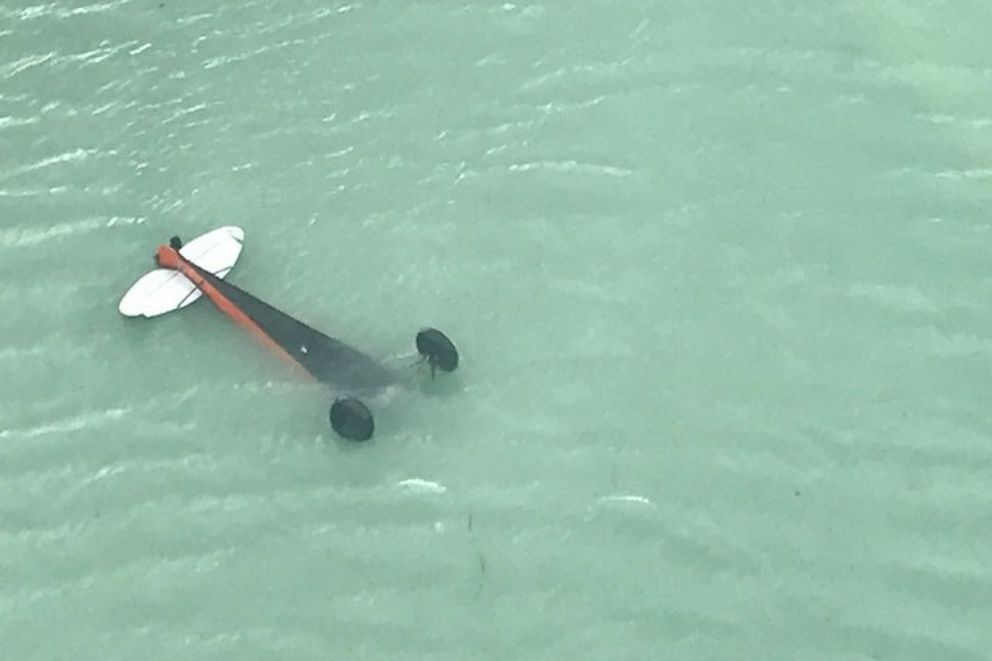 A Coast Guard Air Station Sitka MH-60 Jayhawk helicopter aircrew locates a downed aircraft inverted in Crillon Lake, in Glacier Bay National Park, Alaska, July 18, 2018. (U.S. Coast Guard)