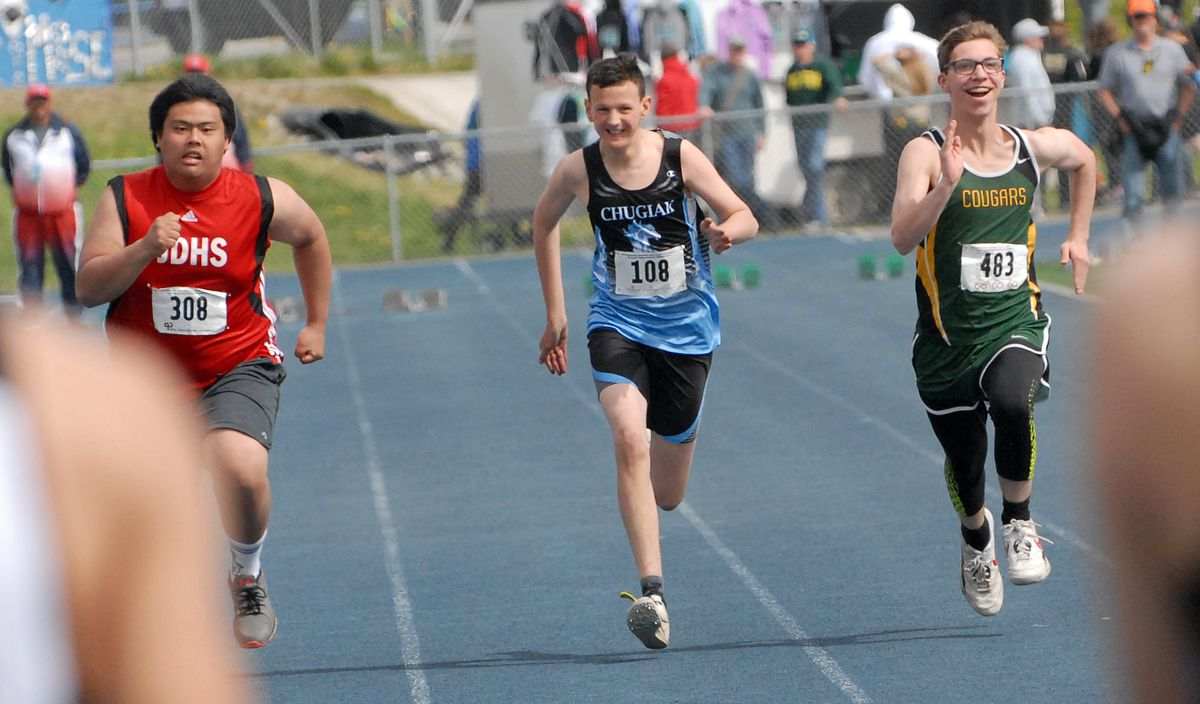 Chugiak's Oz Sparks, center, runs alongside Juneau's Gabriel Canon, left, and Service's Logan Lathrop during the unified 100-meter dash at the ASAA/First National Bank Alaska Division I Track and Field Championships at Machetanz Field in Palmer on Saturday, May 25, 2019. (Matt Tunseth / Chugiak-Eagle River Star)