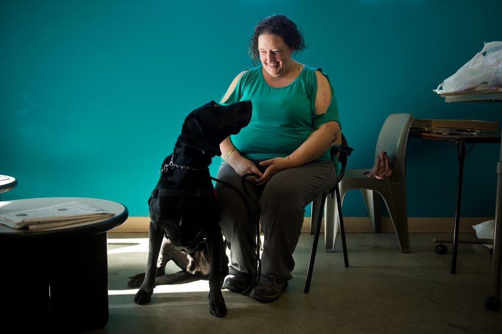Nichole Sandahl recovered from a hospitalization at the Brother Francis Shelter's Medical Respite Program. She now has housing elsewhere with her support dog Kratos. Photographed at Brother Francis Shelter on Sept. 25. (Marc Lester / ADN)