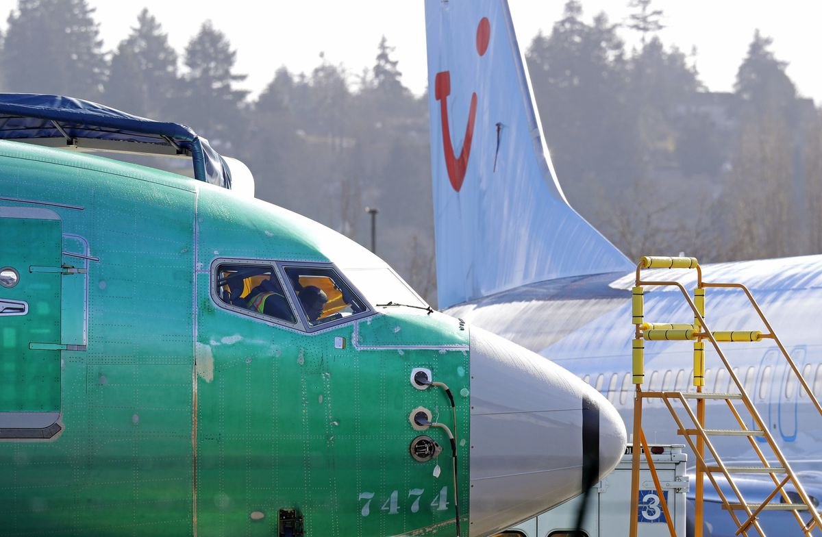 Boeing employees work in the flight deck of a Boeing 737 MAX 8 airplane at Boeing Co.'s Renton Assembly Plant in Renton, Wash. (AP Photo/Ted S. Warren, file)