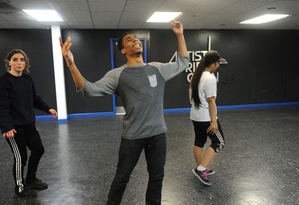 Marcus Freeman celebrates as the dancers including, Robyn Minor and Brenda Wenio, nail a section of the dance as they rehearse a new routine Freeman choreographed on Tuesday, Aug. 2, 2016, in Anchorage. The Artistic Drift crew is preparing for a studio grand opening at the Northway Mall Friday, Aug. 12, 2016. (Bob Hallinen / Alaska Dispatch News)