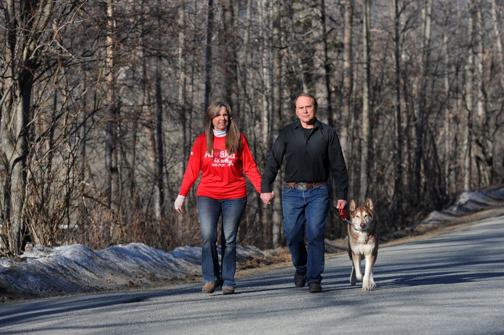 Jodi and Keith Herte and their dog Kiska stroll through their Eagle River neighborhood. (Erik Hill / Alaska Dispatch News)