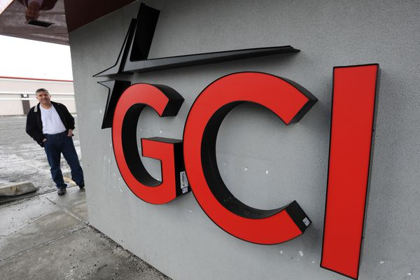 Dino Kadriu waits for the GCI Store at Northern Lights and C Street to open on Tuesday, April 4, 2017. GCI has been acquired by Liberty Ventures Group, a subsidiary of Colorado-based media conglomerate Liberty Interactive Corp. (Bill Roth / Alaska Dispatch News)
