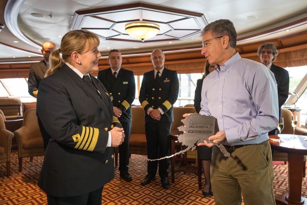Anchorage Mayor Ethan Berkowitz presents a plaque to Captain Inger Thorhauge of the MS Queen Elizabeth on Thursday, May 16, 2019. It is a tradition for cruise ships to exchange plaques with cities the first time they make a call on that port. (Loren Holmes / ADN)