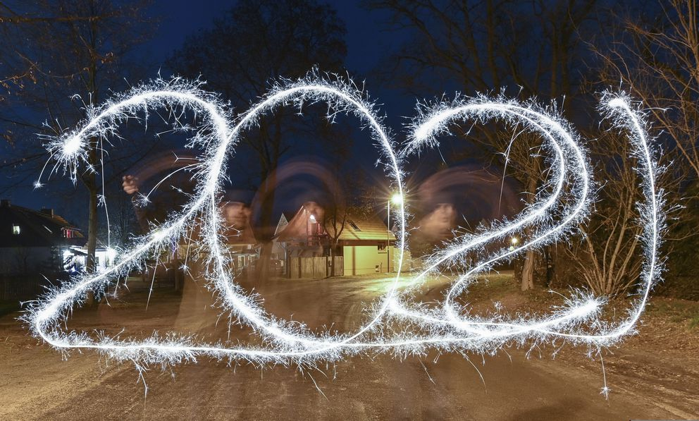 In this long time exposure image, a person appears blurred as he paints 2021 with a sparkler firework to represent the coming year, in the darkness on New Year's Eve, in Briesen, Germany, late Thursday Dec. 31, 2020. (Patrick Pleul/dpa via AP)