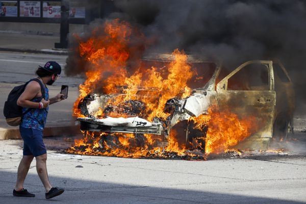 A Pittsburgh Police vehicle burns a during a march in Pittsburgh, Saturday, May 30, 2020, to protest the death of George Floyd, who died after being restrained by Minneapolis police officers on Memorial Day. (AP Photo/Gene J. Puskar)