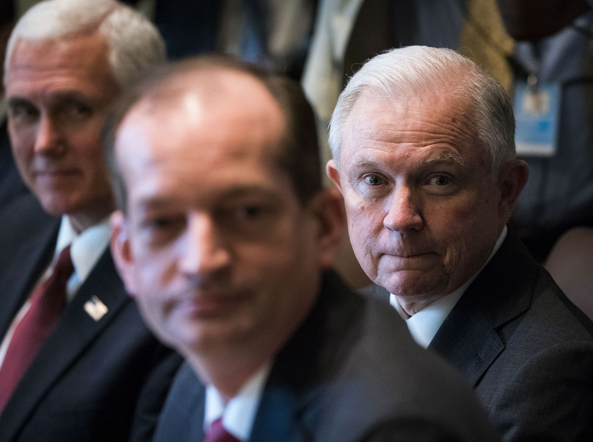 FILE — Attorney General Jeff Sessions, right, looks on with Vice President Mike Pence, left, as President Donald Trump speaks in Washington, June 12, 2017. Eight states legalized marijuana for medical or recreational use last fall, but Sessions is leading a federal push to curb the industry. (Doug Mills/The New York Times)