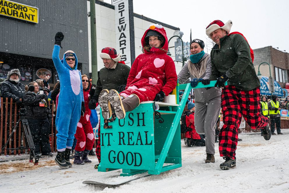 Team Rush It Real Good competes in the Fur Rondezvous outhouse races on Saturday, Feb. 29, 2020 in Anchorage. (Loren Holmes / ADN)