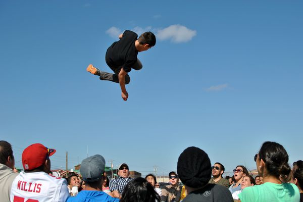 OPINION: Kotzebue is a far cry from road-system Alaska, Mr. President, as you'll learn in the midst of a heartfelt welcome. Pictured: Kotzebue residents take turns at the blanket toss during cultural and Fourth of July celebrations this summer.