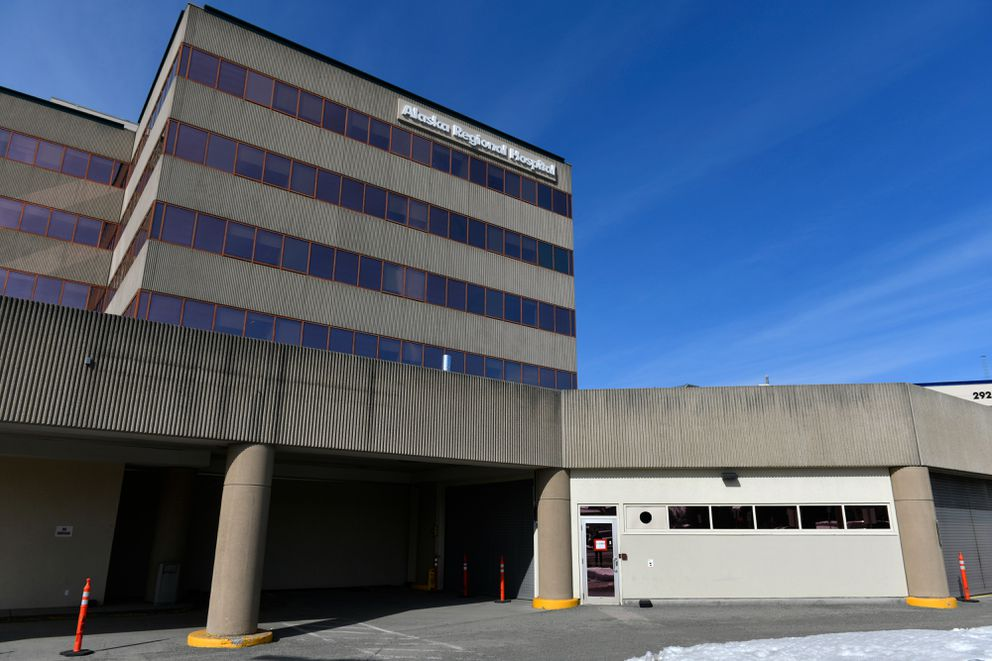 Alaska Regional Hospital's ambulance bay, at right, on the building's east side, has been converted for the care of people suspected to have COVID-19. Photographed March 31, 2020. (Marc Lester / ADN)