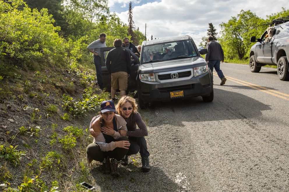 Wendi Yohman is comforted after a searcher was mauled by a bear Wednesday off Hiland Road. Yohman and two others were on foot, searching for Yohman's cousin Mike Soltis, when they were attacked by a brown bear. The man jumped in front of Yohman and the bear attacked him. (Loren Holmes / ADN)