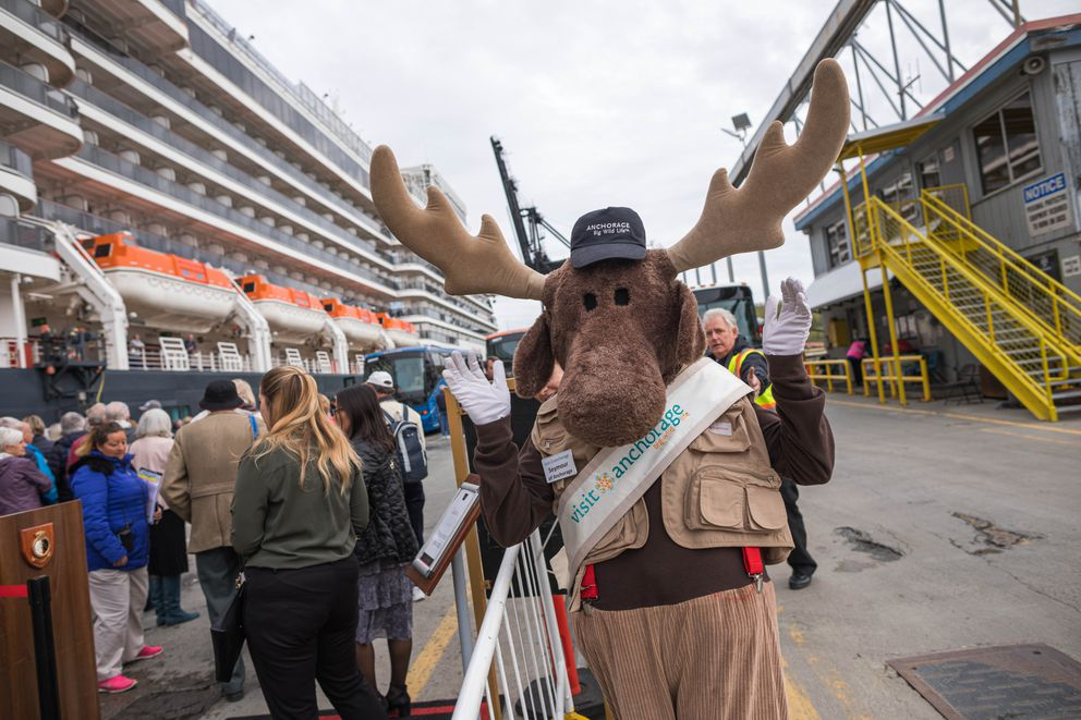 Cameron Peck, dressed as Seymour the Moose, greets passengers disembarking from the MS Queen Elizabeth cruise ship at the Port of Alaska on Thursday. (Loren Holmes / ADN)