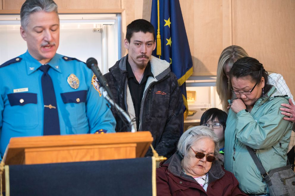 Col. Barry Wilson, director of the Alaska State Troopers, speaks at a press conference Friday, Feb. 15, 2019 announcing the arrest of Steven H. Downs in the 1993 Fairbanks murder of Sophie Sergie. At right is Stephen Sergie, Sophie's brother, Elena Sergie, Sophie's mother, and Olga Tinker-John, Elena's niece. Comforting Olga is Alaska Department of Public Safety Commissioner Amanda Price. (Loren Holmes / ADN)