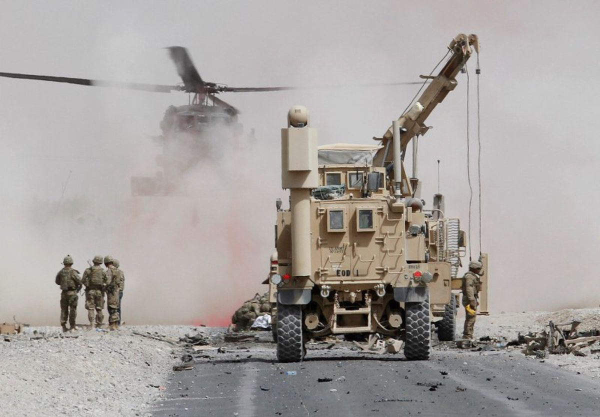 U.S. troops assess the damage to an armored vehicle of NATO-led military coalition after a suicide attack in Kandahar province, Afghanistan August 2, 2017.REUTERS/Ahmad Nadeem