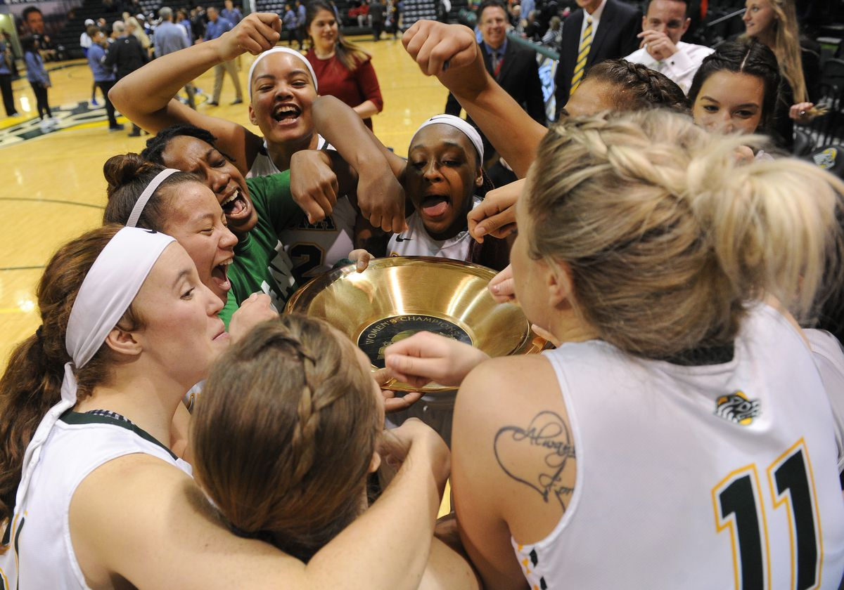 The UAA women's basketball team celebrates its Great Alaska Shootout championship in November. (Bob Hallinen / ADN)