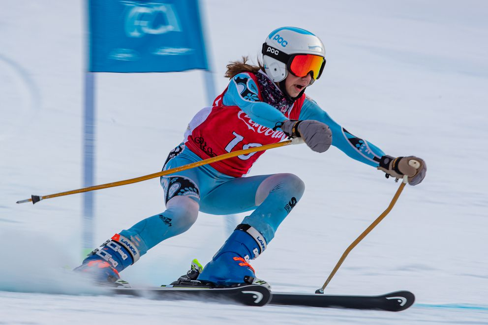 Lucy Lukes, a first-year racer, savors the moment as she passes a giant slalom gate Sunday at the Coca-Cola Classic at Alyeska. (Photo by Bob Eastaugh)