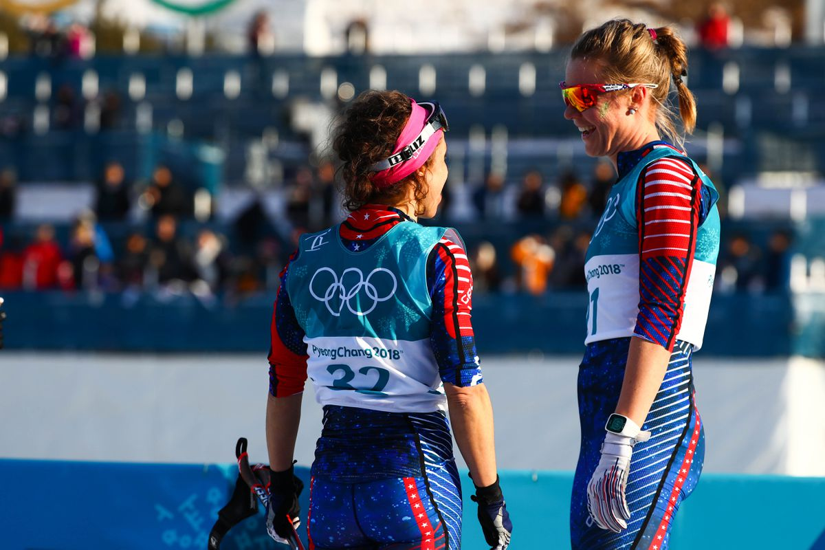 Alaska pacific University skiers Rosie Frankowski, left, and Sadie Bjornsen at the finish line of the women's 30K classic Sunday at the Winter Olympics. (Guy Rhodes-USA TODAY Sports)