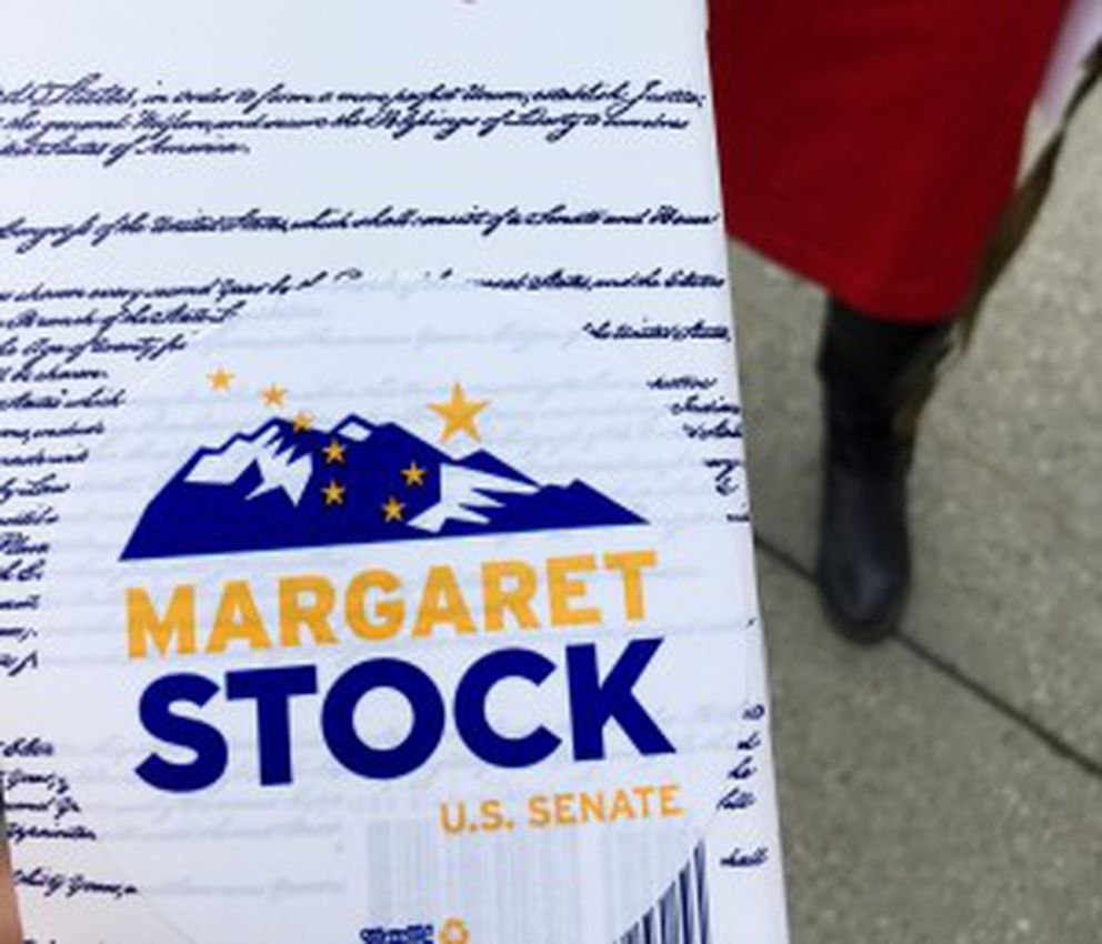 Alaska Senate candidate Margaret Stock offers up a pocket U.S. Constitution outside the Alaska Division of Elections after filing signatures required to join the ballot as an Independent candidate. August 12, 2016 (Erica Martinson / Alaska Dispatch News)
