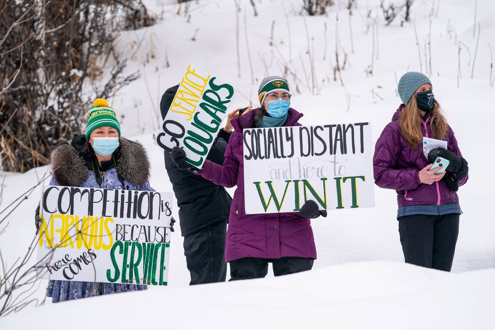 Service High School parents Itsy Hlasny, left, and Eva Hancock cheer on skiers. (Loren Holmes / ADN)