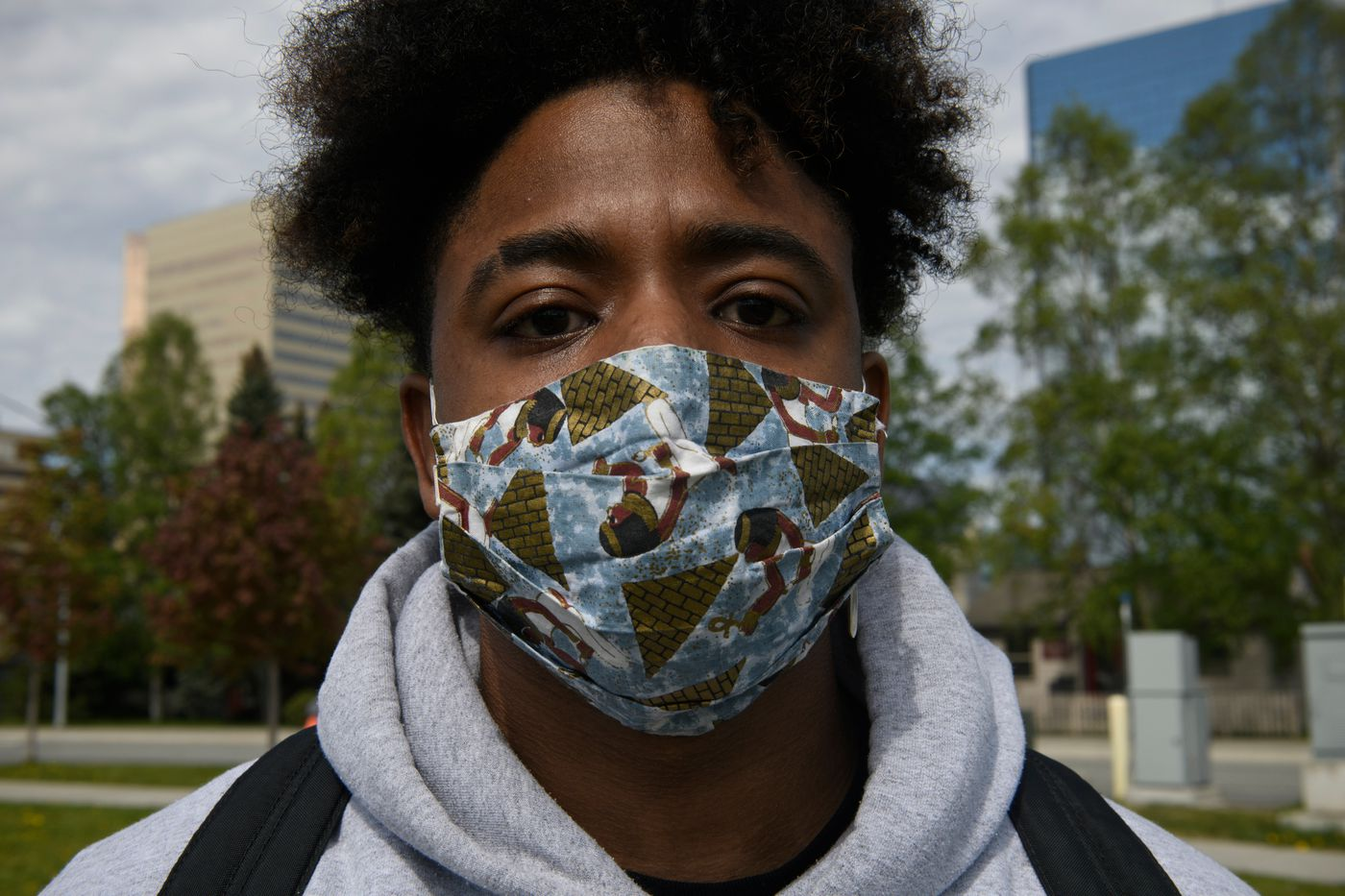 Adrian Patterson wears an Egyptian pyramid-themed mask. (Marc Lester / Anchorage Daily News)