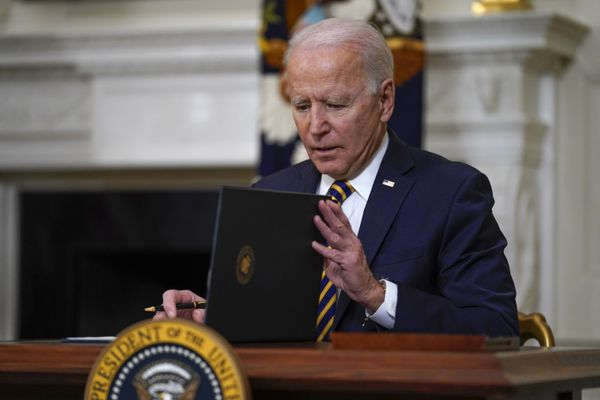 President Joe Biden closes the folder after signing an executive order relating to U.S. supply chains, in the State Dining Room of the White House, Wednesday, Feb. 24, 2021, in Washington. (AP Photo/Evan Vucci)