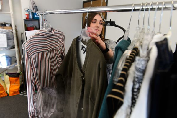 Kortnee Ferriss steams items accepted for consignment at The Clothesline Consignment store on Northern Lights Boulevard on January 17, 2019. (Marc Lester / ADN)