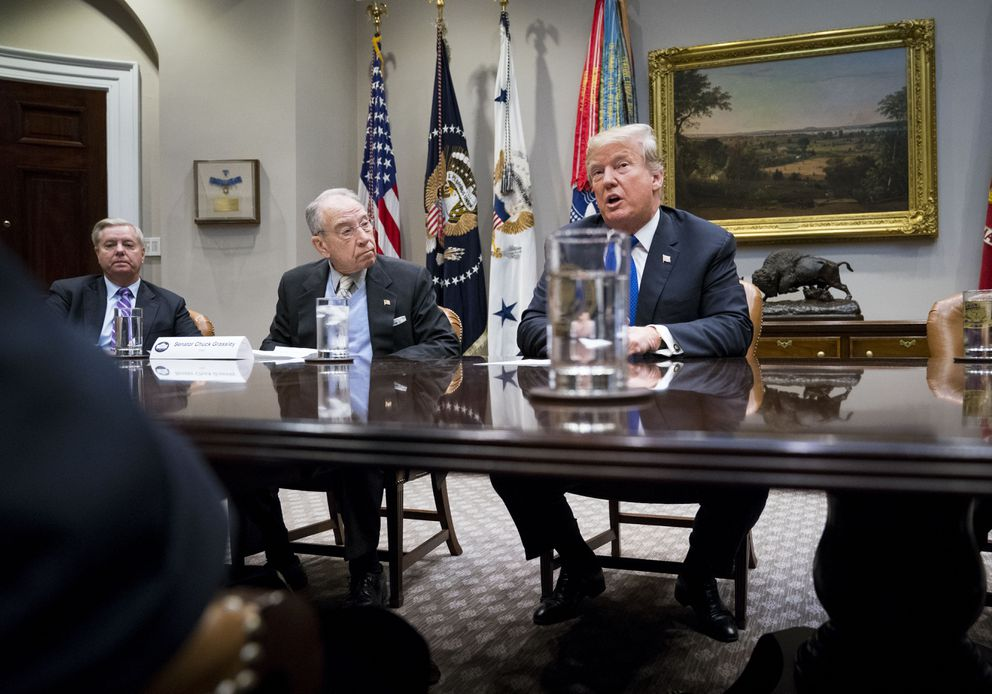 From left, Senators Lindsey Graham (R-S.C.) and Chuck Grassley (R-Iowa) listen as President Donald Trump speaks during a meeting on immigration at the White House on Jan. 4, 2018. More than a year after Republican leaders promised to investigate Russian interference in the presidential election, Graham and Grassley, two influential Republicans, on Jan. 5 made the first known congressional criminal referral in connection with the meddling — against Christopher Steele, one of the people who sought to expose it. (Doug Mills/The New York Times)