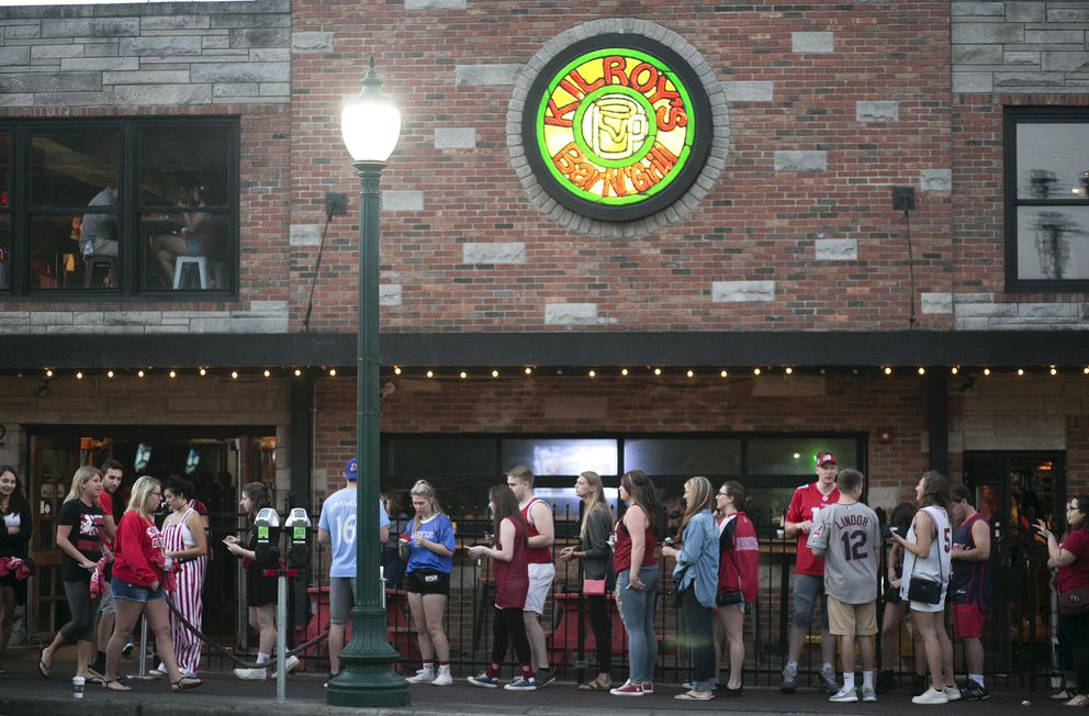 A line outside Kilroy's Sports Bar, one of the most popular college bars in the country, near Indiana University in Bloomington, Ind., on Sept. 24. (Maddie McGarvey/The New York Times)