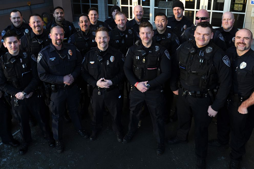APD swing shift officers display their Movember mustaches before hitting the streets on Monday, Nov. 20, 2017. (Bill Roth / ADN)