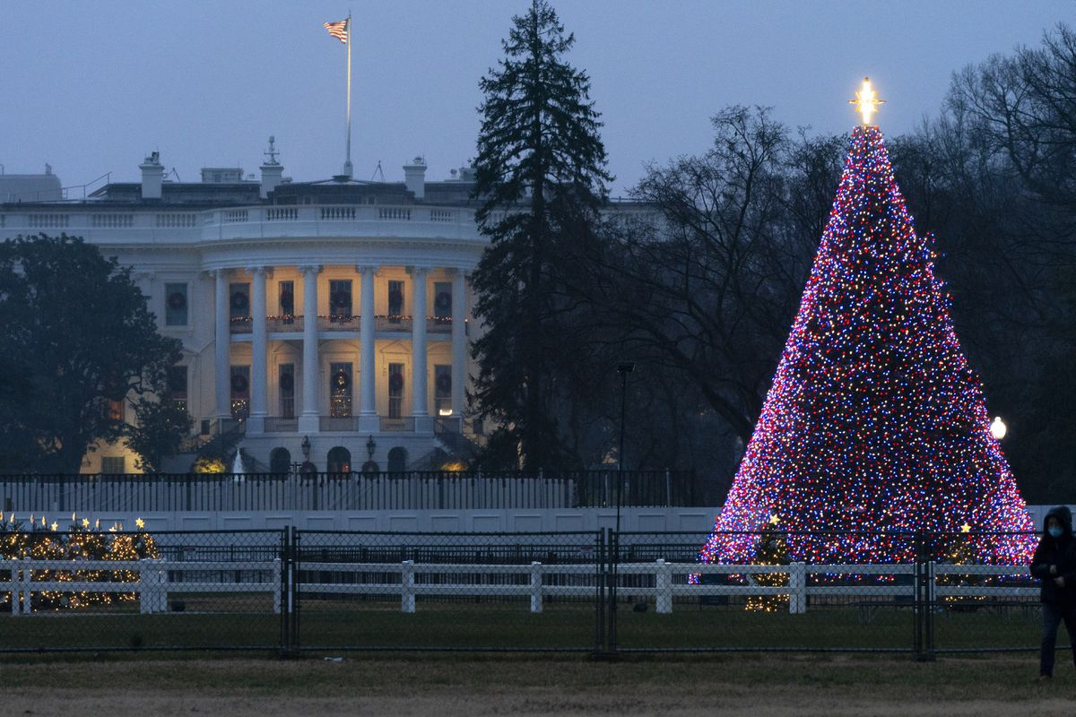 The National Christmas Tree glows with lights on the Ellipse near the White House, Thursday, Dec. 24, 2020, on Christmas Eve in Washington. (AP Photo/Jacquelyn Martin)