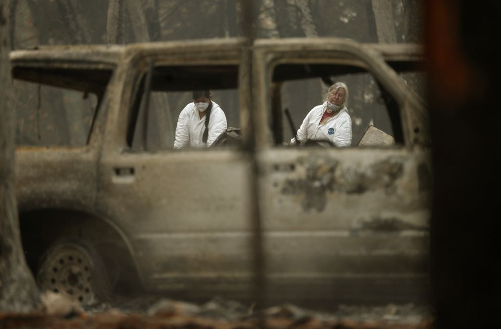 Investigators recover human remains at a home burned in the Camp Fire, Thursday, Nov. 15, 2018, in Magalia, Many of the missing in the deadly Northern California wildfire are elderly residents in Magalia, a forested town of about 11,000 north of the destroyed town of Paradise, Calif. (AP Photo/John Locher)