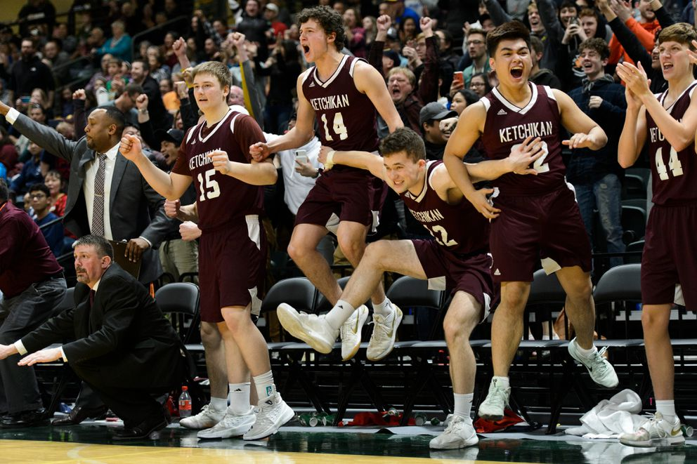The Ketchikan bench erupts late in the game. Ketchikan beat Dimond in the boys 4A basketball state championship game on March 23, 2019. (Marc Lester / ADN)