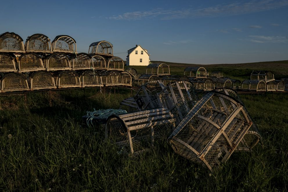 Lobster traps spill across a field in the Magdalen Islands, where fishing has been a way of life for centuries. (Washington Post photo by Bonnie Jo Mount)
