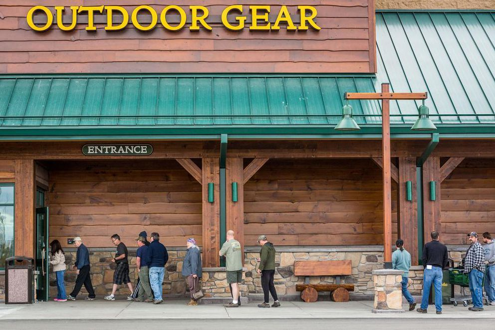 Customers wait in line outside the Anchorage Cabela's on May 7, 2014. (Loren Holmes / ADN archive)