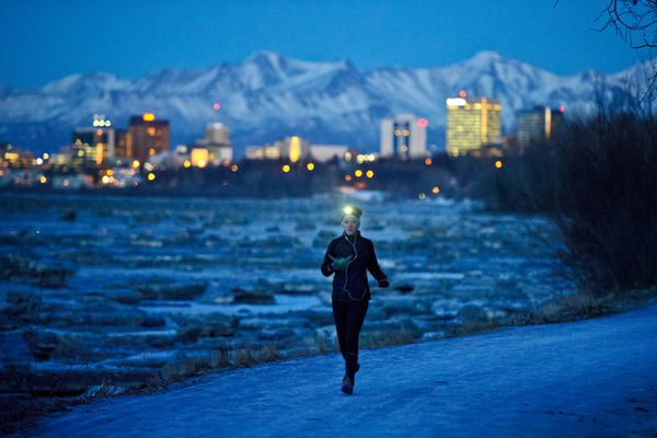 Sabrina Walker runs along the Tony Knowles Coastal Trail just after sundown on Tuesday, January 5, 2016. (Marc Lester / Alaska Dispatch News)