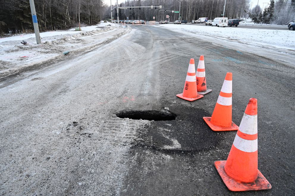 A sinkhole that opened up Wednesday morning Dec. 11, 2019, in the westbound lanes of Northern Lights Blvd. is directly over the culverts carrying Chester Creek under the roadway. (Anne Raup / ADN)