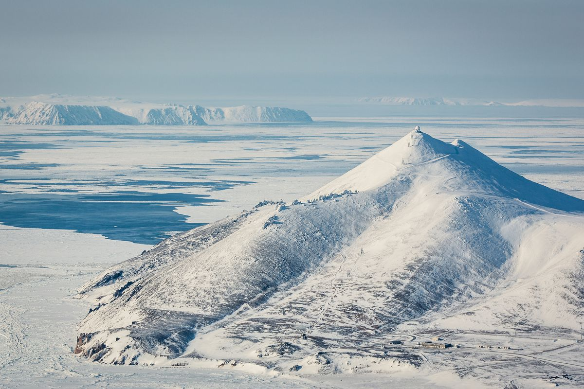 Little Diomede Island in the Bering Strait is visible from the edge of the Seward Peninsula across waters included in the Obama administration's new Northern Bering Sea Climate Resilience Area. Chukotka, Russia, is also visible in the distance. (Loren Holmes / ADN archive 2013)