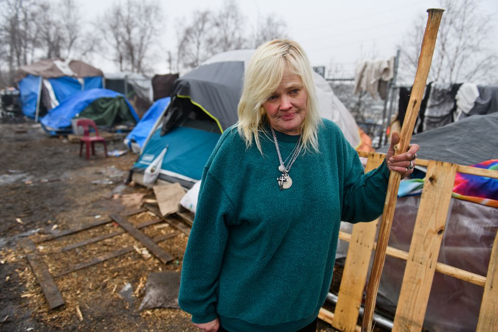 """Lisa Lozano described living in a homeless camp near Third Avenue and Ingra Street as stressful because of the concern for food and heat. """"We don't have another place to live, ' she said. (Marc Lester / ADN)"""